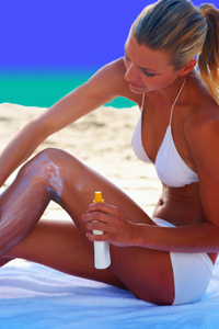 Woman Applying Formulated OTC Skin Care Suntan Lotion to Her Hands and Skin at Beach
